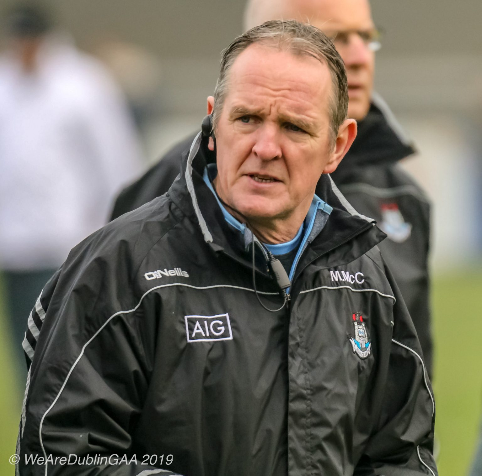 Dublin hurling manager Mattie Kenny in a black rain jacket with the Dublin and AIG crests on the chest has injury concerns ahead of his sides opening Leinster championship game against Kilkenny