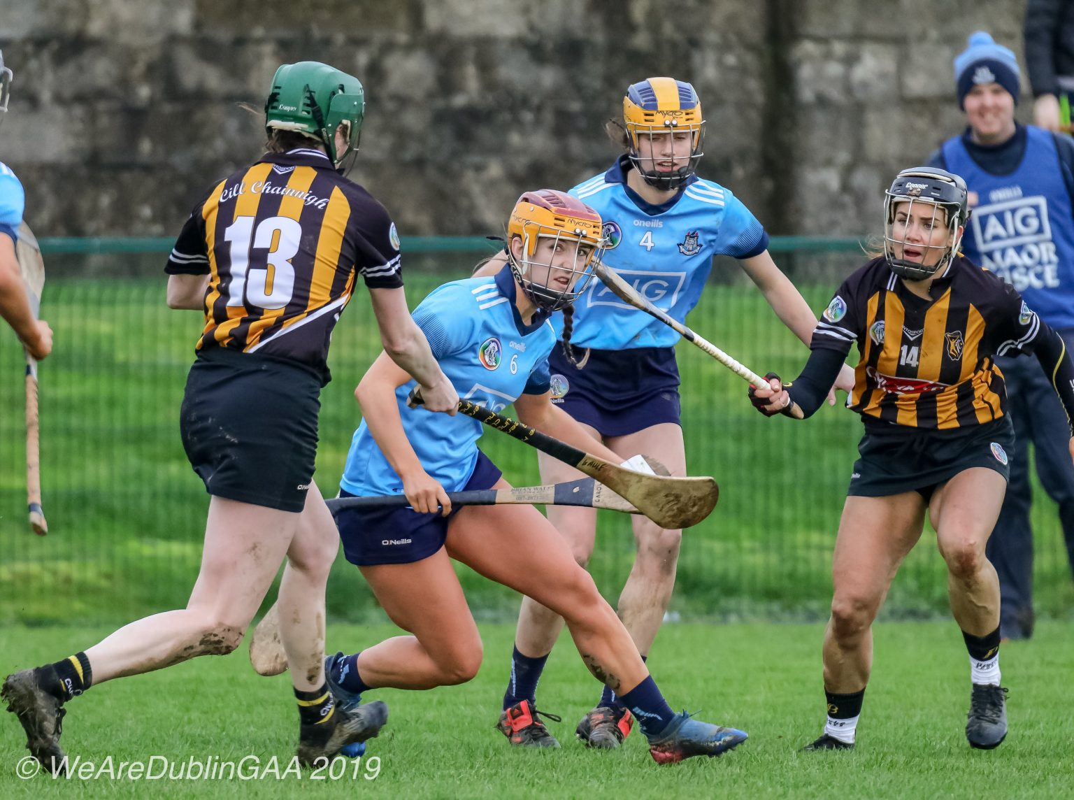 Two Dublin Camogie Players In sky blue jerseys and navy skorts in action against two Kilkenny players in black and amber striped jerseys and black skorts both sides meet in the Leinster Senior Camogie championship quarter final